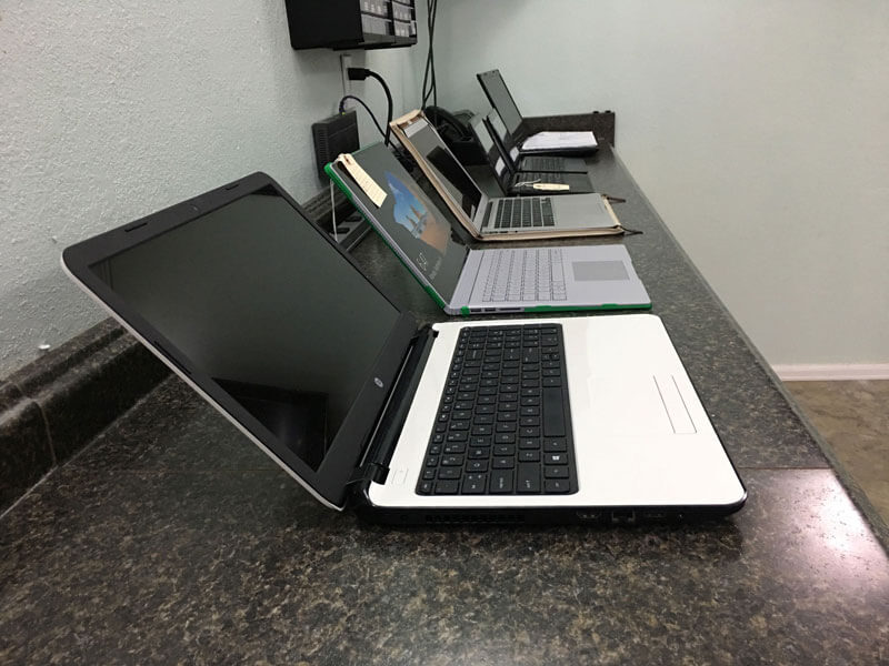 Laptops on computer repair bench