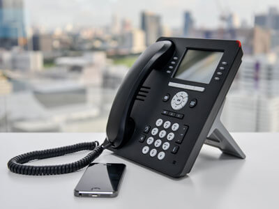 VoIP desk phone and smartphone