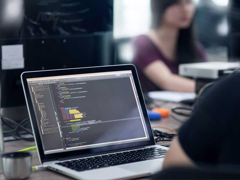 Web development code on laptop